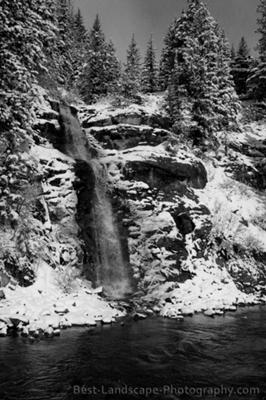 seasonal waterfall with snow in black & white