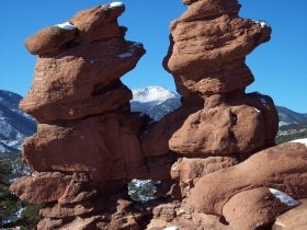Pikes Peak, as seen through the Siamese Twins rock formation